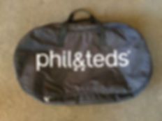 Phil and Teds carry cot packed up in its bag for holiday