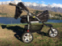 Urbin stroller by Lake Wakatipu Queenstown New Zealand and the Remarkables