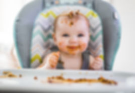 hungry baby sitting in a rockababy rentals highchair in Queenstown New Zealand