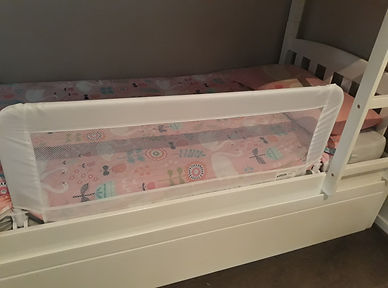 Dreambaby bed rail set up on a bunk bed in Queenstown accommodation for a small child on holiday