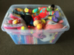 Toys and books for babies in a 60 litre toy box from Rockababy Rentals Queenstown