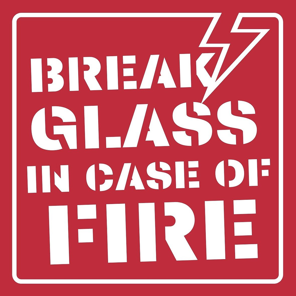 "A common statement on many emergency boxes ""Break Glass in Case of FIre""."