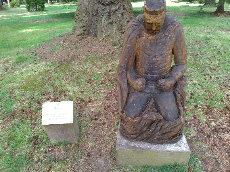 A Carved Wooden Statue on a King from MacBeth. He is in open woodland in Angus at Glamis Castle
