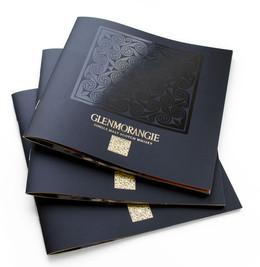 Напечатанный по разработанному дизайну дорогой каталог с уф-лаком и тиснением