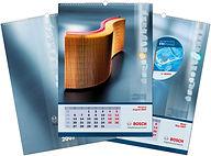 Напечатанный тираж вертикальных настенных перекидных календарей формата А2 на пружине с ригелем по короткой стороне, выполненный на заказ в типографии полного цикла BTL print