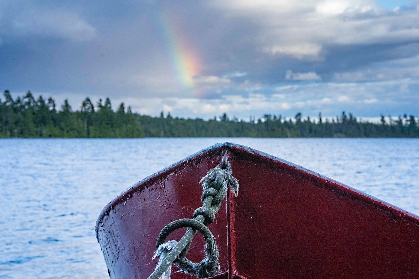 Red steel boat and rainbow
