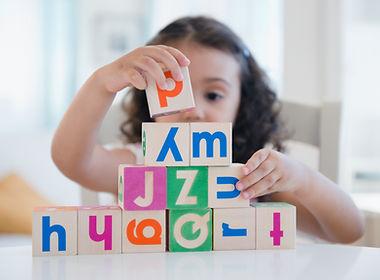 Child training to hold stack blocks