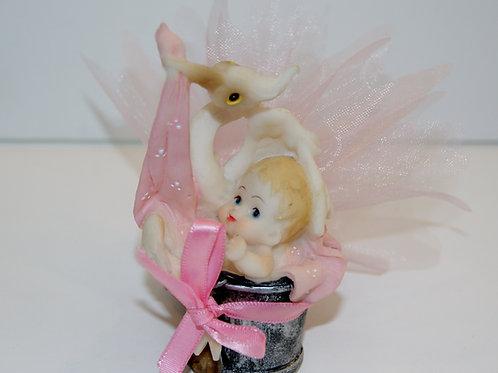 Bébé cigogne dans pot