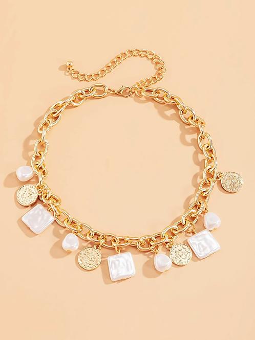 Collier chaine dorée et pierres blanches