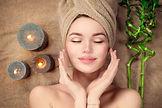 beautiful-spa-woman-towel-her-head-lying-touching-face-skin-skincare-beauty-smiling-model-