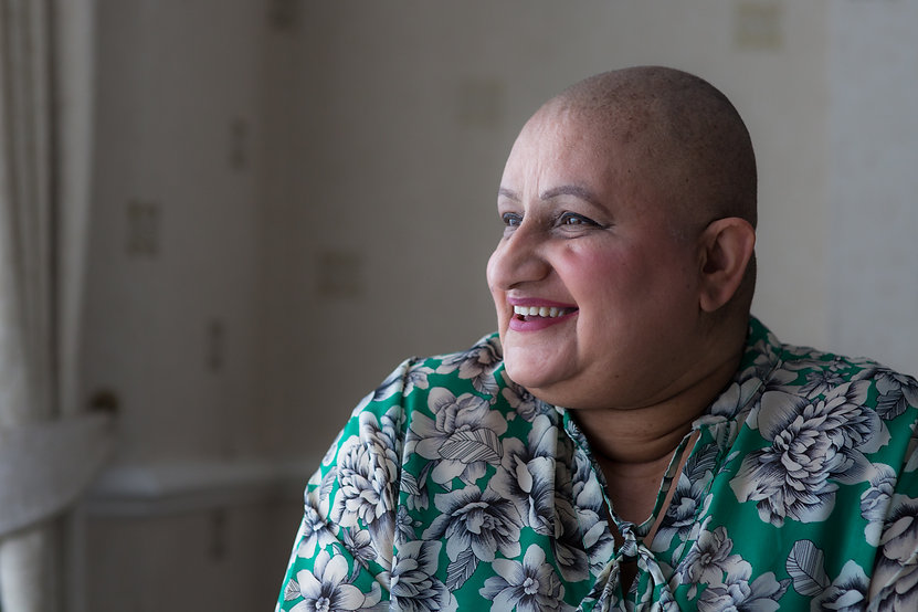 Cancer patient photographed at home
