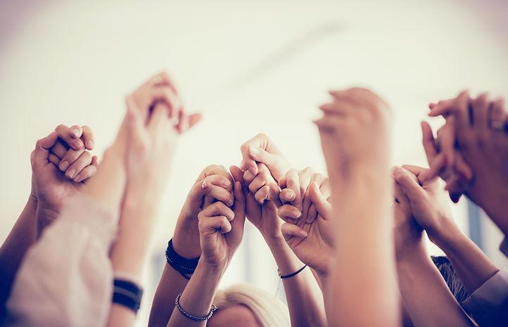 Women Holding Hands