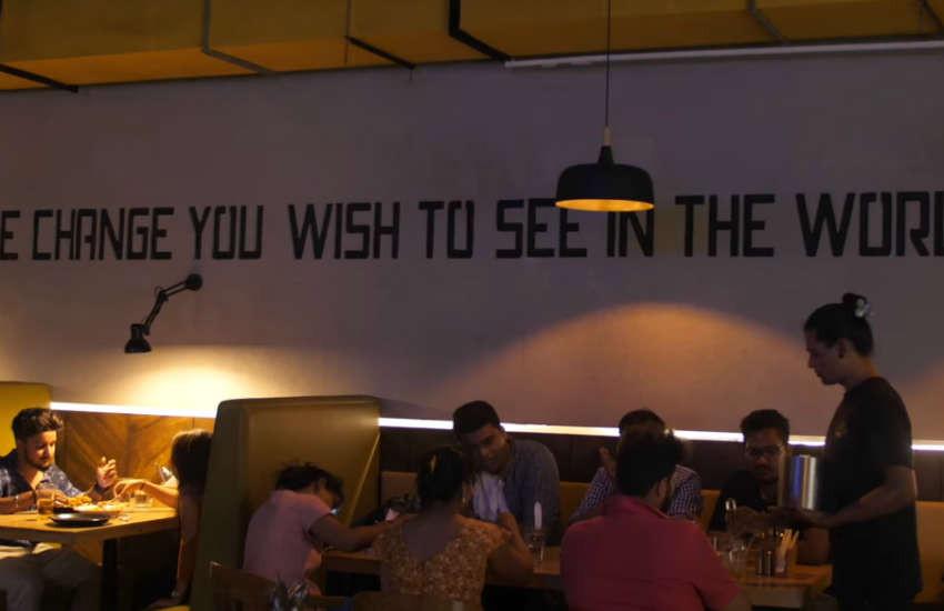 People eating at Third Eye Cafe in Navi Mumbai, India