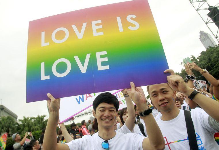 Men marching at Taipei Pride Parade