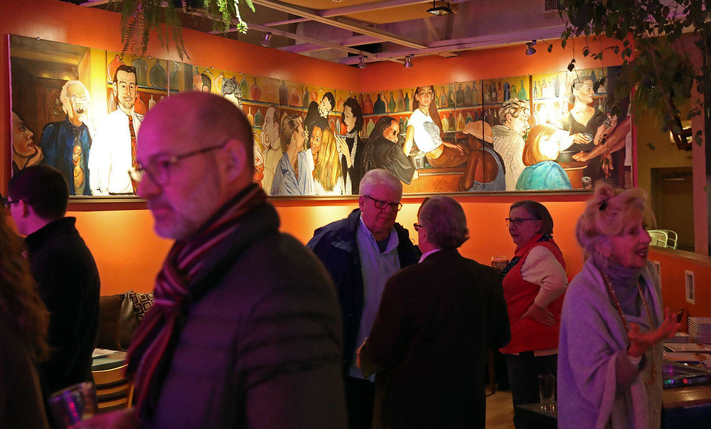 Escafe - Scheduled to close in two weeks, Escafe owner Todd Howard held an open house to celebrate the restaurant and the artwork on its walls, which depicts former employees and longtime patrons