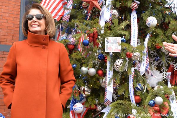 Nancy Pelosi in sunglasses posing for photograph