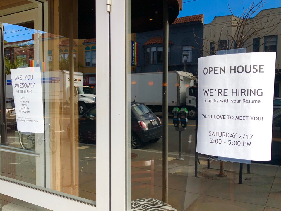 "Hamburger Mary's ""We're Hiring"" flier on front door"