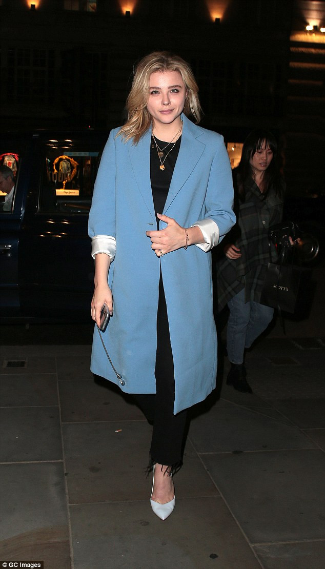 Chloe Grace Moretz in a sky blue overcoat and all-black outfit as she enjoyed dinner at Scott's in London on Tuesday