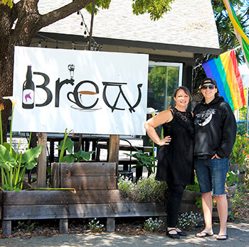 Owners Alisse Cottle, left, and her fiancée, Jessica Borrayo, stand in front of Brew Coffee and Beer House, Santa Rosa's queer-owned cafe