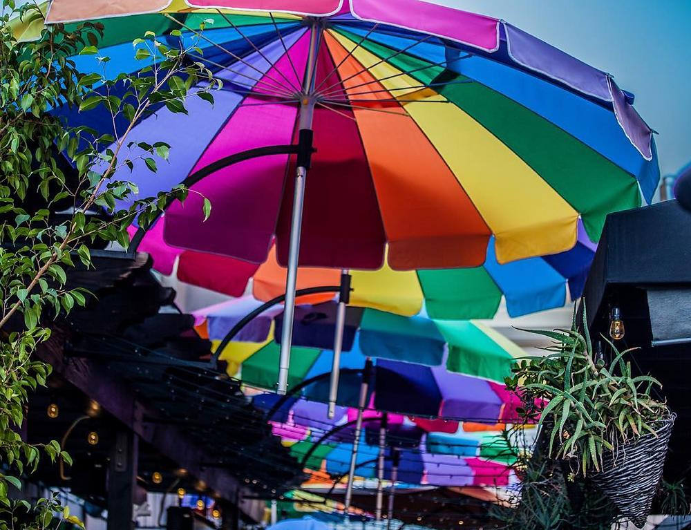 Pride umbrellas at outdoor cafe in San Diego