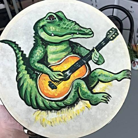Gator on a tambourine