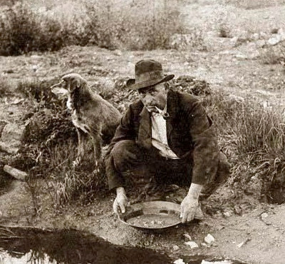 Gold prospector panning for gold during the gold rush. If only he had bought a home improvement franchise.