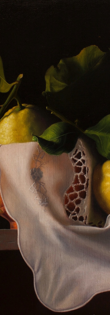 Lemons with white cloth and copper vase