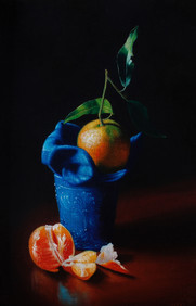 Clementines and blue glass