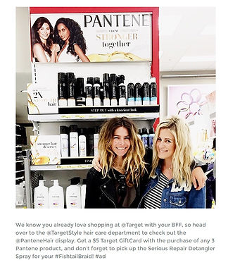 Two women smiling in front a pantene stall