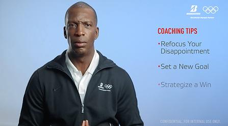 Micheal Johnson giving coachin tips for the bridgestone campaign