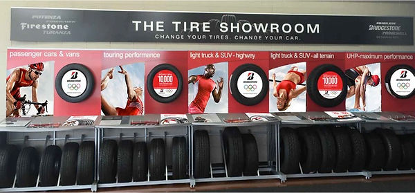 Bridgestone tire showroom with posters of different athletes.