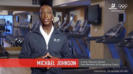 Micheal Johnson a 4 time olympic gold medalist promoting bridgestone
