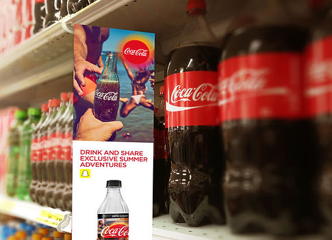 Poster of summer campaig next to a coca-cola bottle
