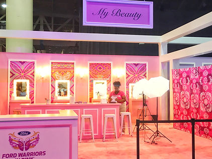 A pink beauty booth at the Ford Essence 10th year anniversary