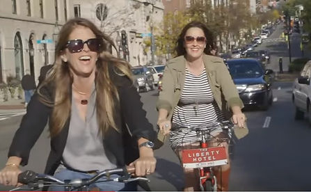 Two girls riding a bike featured in East Coast Road Trip
