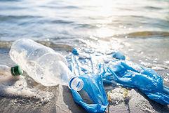 plastic-bag-bottles-beach-seashore-water