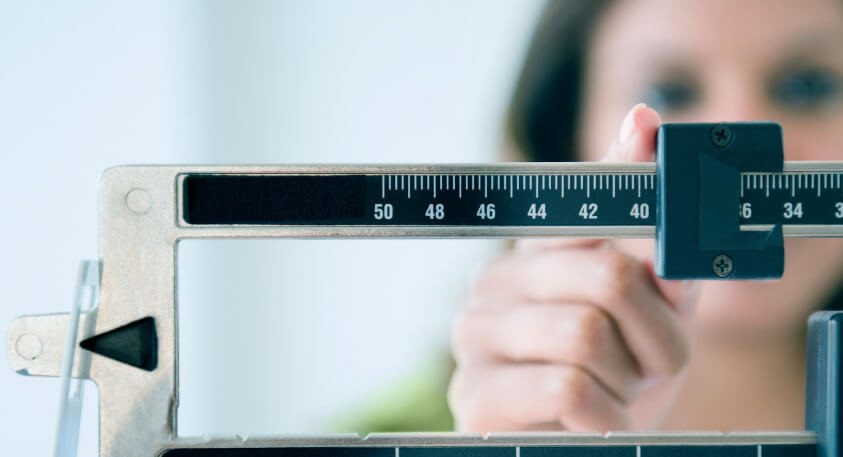 Diabetes: Tipping the Scales, woman on scale
