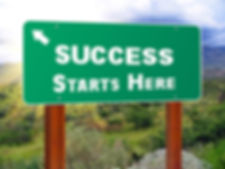 Highway sign that says Success Starts Here