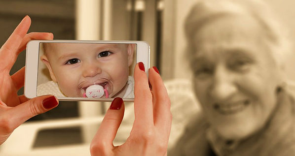 Daughter taken a photo of her elderly mom, in camera phone shows a baby image of her mom.