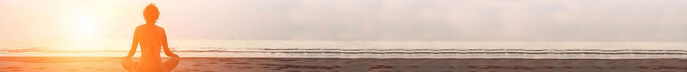 Woman on shoreline meditating