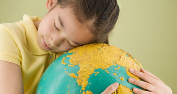 Little Girl Hugging a Globe. The Most Precious Gem in the World.