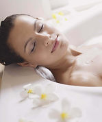 Woman relaxing in a bath of Epsom Salts link you might also like.