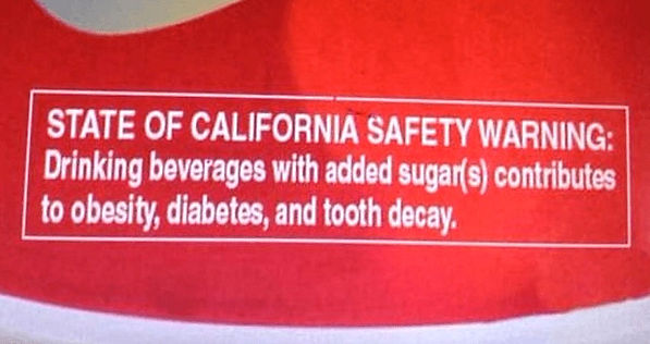 State of California Sugar Safety Warning on a can of pop.