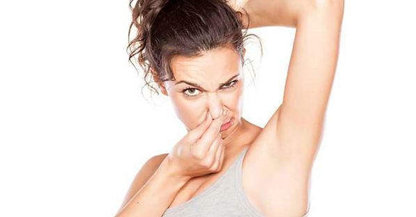 Woman holding her nose to her body odor (BO)