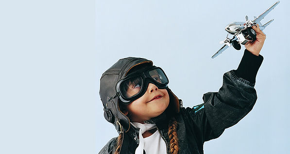 Little girl pretending to be a pilot. Teach and Learn.