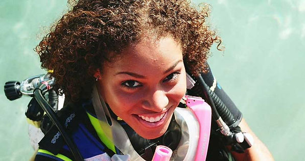 Stress is all in the mind, Happy woman scuba diving.