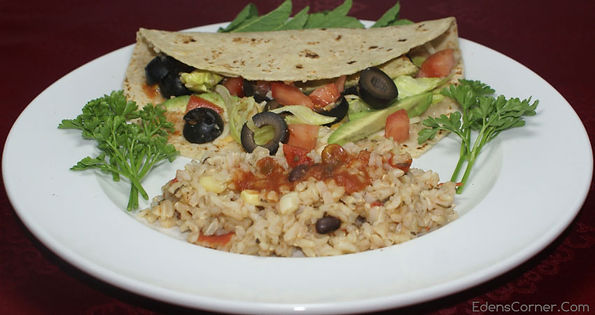 Plate of Bean Wrap, rice and garnish.