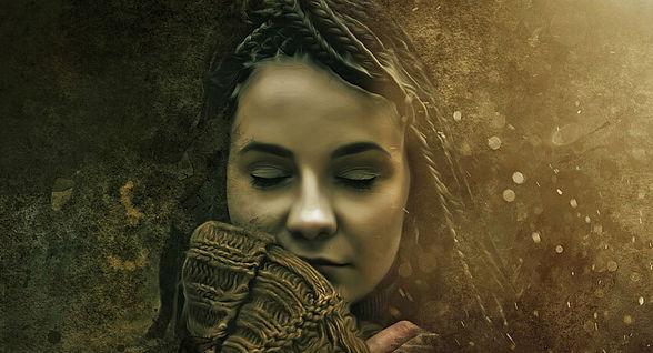 A woman with eyes closed, awakening her spirit.