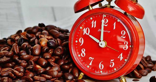 Coffee beans and alarm clock.
