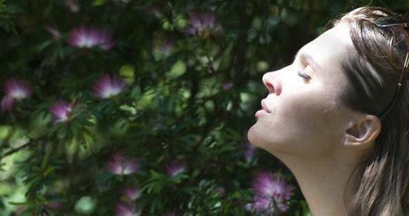 Breathe, woman managing stress through breathe.